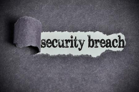 security breach: security breach word under torn black sugar paper.