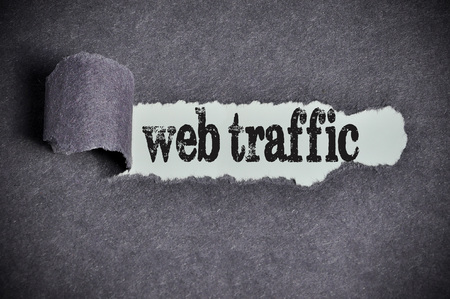 web traffic: web traffic word under torn black sugar paper.