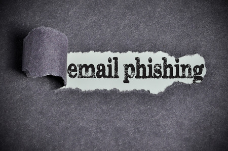 web scam: email phishing word under torn black sugar paper. Stock Photo