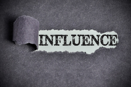 under the influence: influence word under torn black sugar paper.