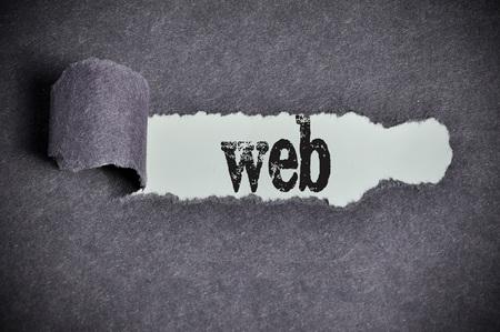 web hosting: web word under torn black sugar paper.