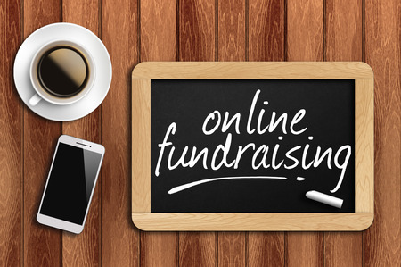 business funds: The coffee, phone  and chalkboard with word online fundraising
