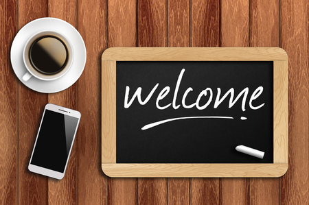 sentiment: The coffee, phone  and chalkboard with word welcome