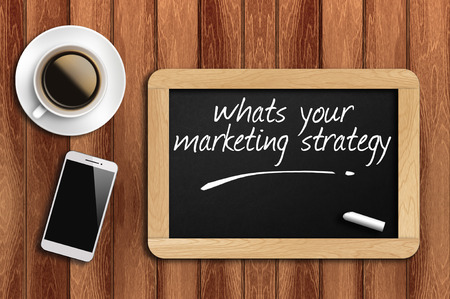 page rank: The coffee, phone  and chalkboard with word whats your marketing strategy