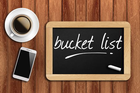 coffee, phone  and chalkboard with  word bucket list.