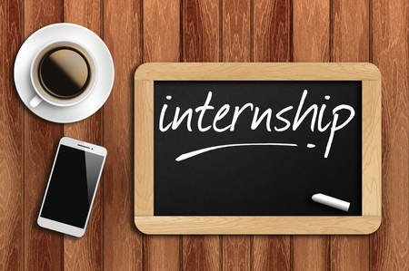 internship: The coffee, phone  and chalkboard with word internship