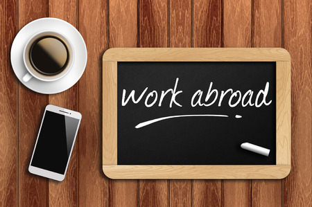 abroad: The coffee, phone  and chalkboard with  word work abroad