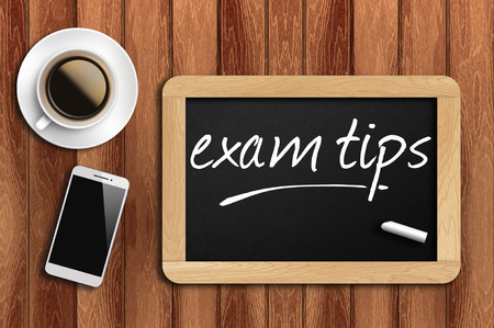 The coffee, phone  and chalkboard with  word exam tips