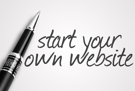 own: pen writes start your own website on white blank paper. Stock Photo