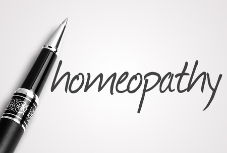 homeopathy: pen writes homeopathy on white blank paper.