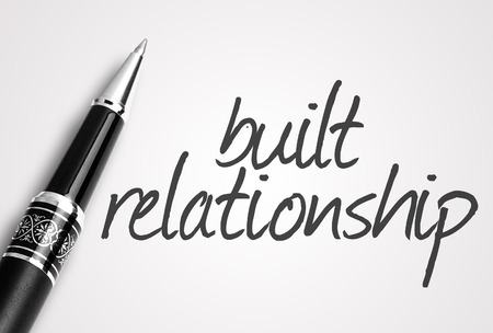 trustful: pen writes built relationship on white blank paper. Stock Photo