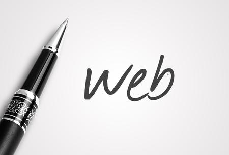 web hosting: pen writes web on white blank paper. Stock Photo