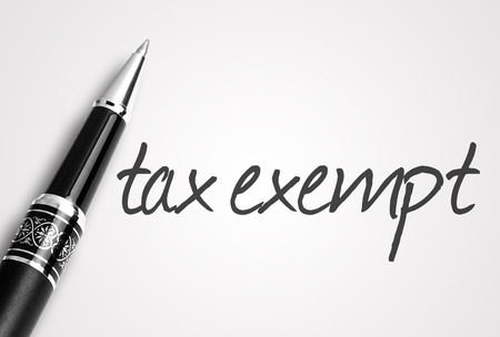 exempt: pen writes tax exempt on white blank paper.