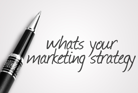 page rank: pen writes whats your marketing strategy on white blank paper. Stock Photo