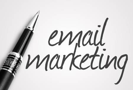 pen writes email marketing on white blank paper. Archivio Fotografico