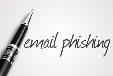 web scam: pen writes email phishing on white blank paper.