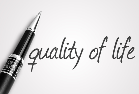 zest for life: pen writes quality of life on white blank paper. Stock Photo