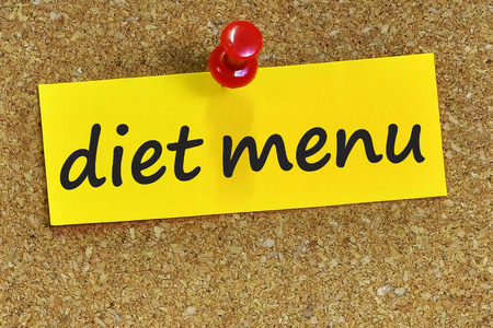 fiber food: diet menu word on yellow notepaper with cork background.