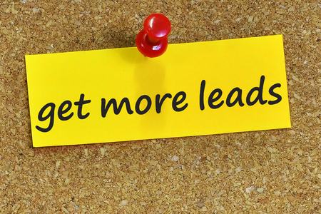 leads: get more leads word on yellow notepaper with cork background.