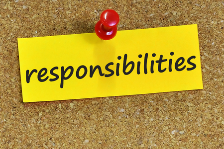 responsibilities: responsibilities word on yellow notepaper with cork background. Stock Photo