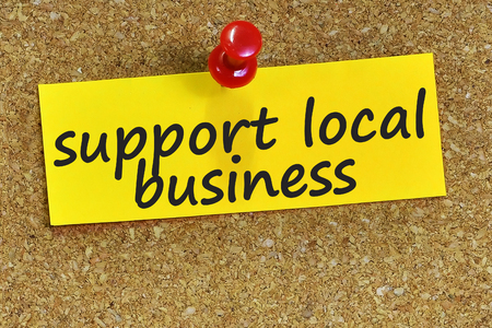 local business: support local business word on yellow notepaper with cork background. Stock Photo