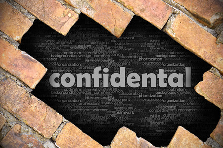 government services: The hole in the brick wall with word confidental