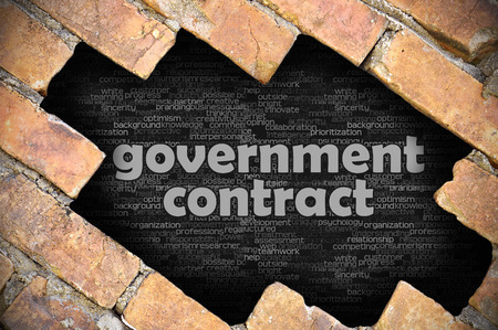 The hole in the brick wall with word government contract