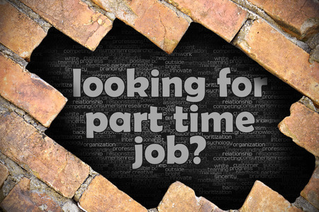 The hole in the brick wall with word looking for part time job? Stock Photo