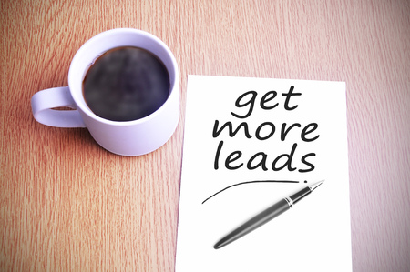 prospecting: Black coffee on the table with note writing get more leads Stock Photo