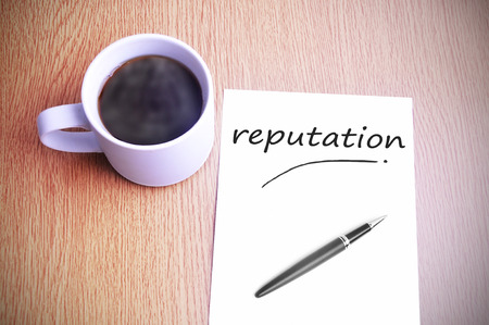 reputable: Black coffee on the table with note writing reputation