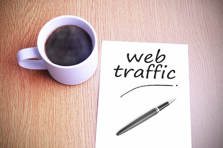 web traffic: Black coffee on the table with note writing web traffic