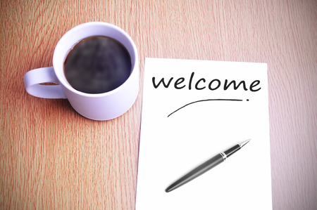 sentiment: Black coffee on the table with note welcome