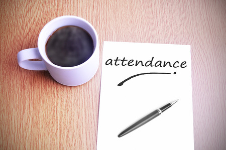 Black coffee on the table with note writing attendance
