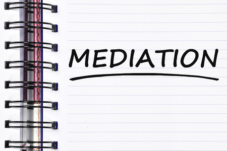 mediation: mediation words on spring white note book. Stock Photo