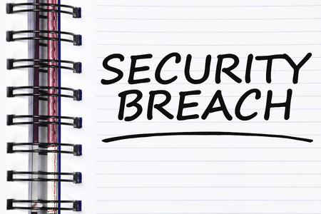 security breach: security breach words on spring white note book. Stock Photo