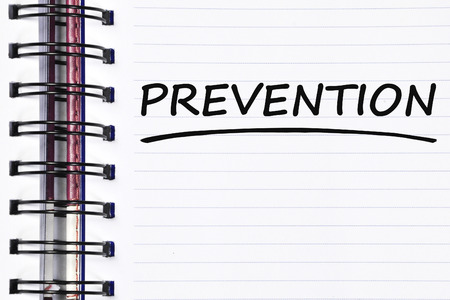 prevent: prevention words on spring white note book.