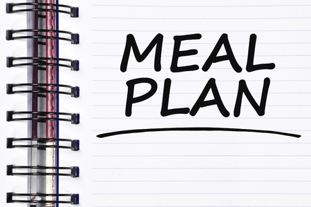 meal plan words on spring white note book.