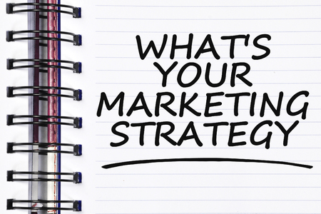 Marketing Strategy: whats your marketing strategy words on spring white note book.