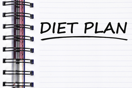 toxins: diet plan words on spring white note book. Stock Photo