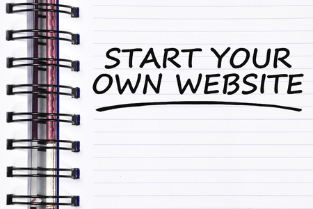 website words: start your own website words on spring white note book.