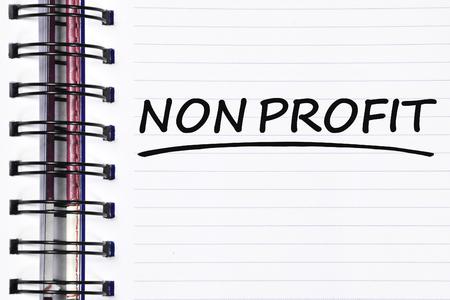 non profit: non profit words on spring white note book. Stock Photo