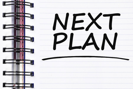 what's ahead: next plan words on spring white note book.