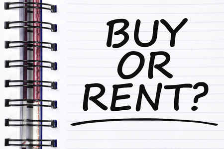 owning: buy or rent? words on spring white note book.