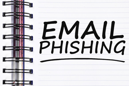 web scam: email phishing words on spring white note book.