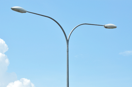 lamp on the pole: Y shape street lamp pole with blue sky. Stock Photo