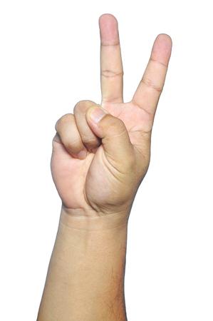 signo de paz: Mano muestran dos dedos hacia arriba o signo de la paz aislado en blanco.