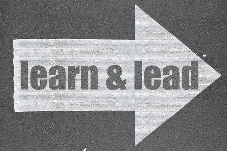 learn and lead: Arrow on asphalt road written word learn & lead .