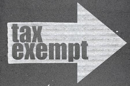 exempt: Arrow on asphalt road written word tax exempt  . Stock Photo