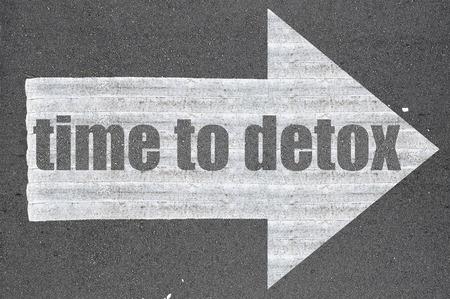regenerate: Arrow on asphalt road written word time to detox  .