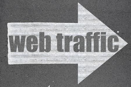 web traffic: Arrow on asphalt road written web traffic  . Stock Photo